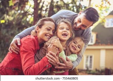 Family group hug . Autumn season.
