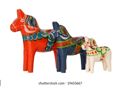 A Family of Hand carved Wooden horses from Dalarna Sweden.