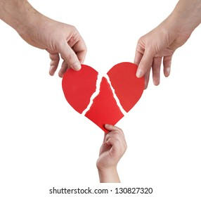 family hands connecting torn pieces of hart, clipping path included