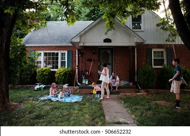 family hanging outside at home
