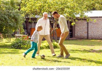 family, happiness, generation, home and people concept - happy family playing football in front of house outdoors