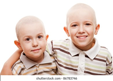 Family happiness - two little smiling child boy brothers with bald shaved heads