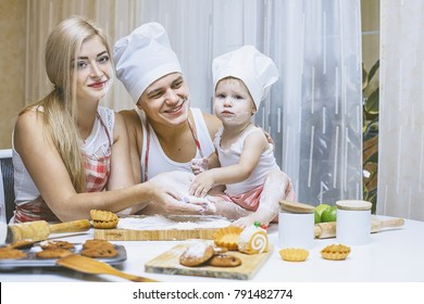 Family, happy daughter with dad and mom in home kitchen laughing and preparing food together, with love