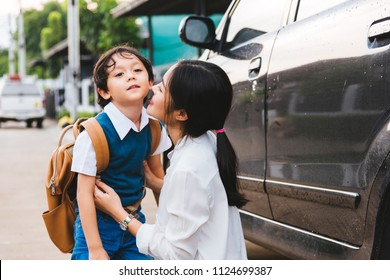 Family happy mother mom send children kid son boy kindergarten to school, education back and back to school concept