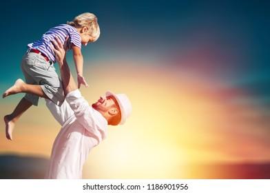Family happy outside sunset vacation lifestyle hug
