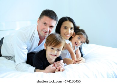 Family happy and relaxing in bedroom. mother, father, son , daughter