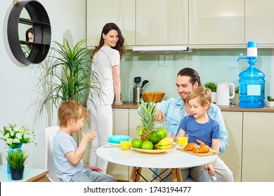The family has Breakfast in the kitchen