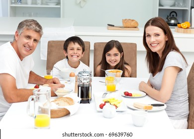 Family having breakfast in the kitchen at home