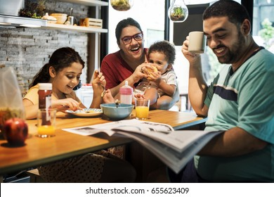 Family having breakfast together in the morning