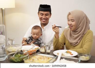 family having early breakfast before dawn. sahoor or sahur on ramadan