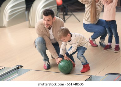 Family having fun at bowling club