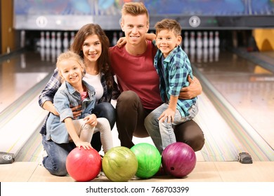 Family having fun in bowling club
