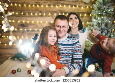 family having fun in christmas house