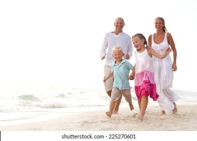 Family having fun on the beach.