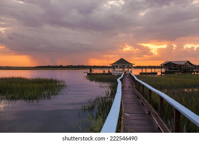 family having fun on dock at sunset with approaching storm