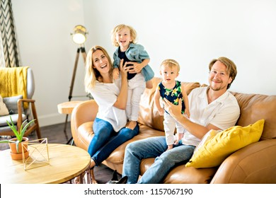 Family having fun on sofa.