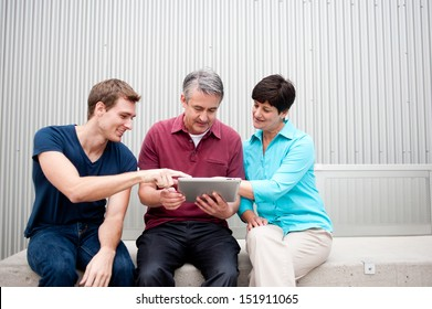 family having fun on tablet