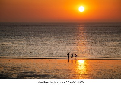 family having fun relaxing in sunset, travel norderney Germany