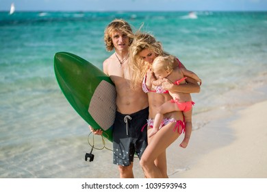 Family having fun surfing together, summer lifestyle
