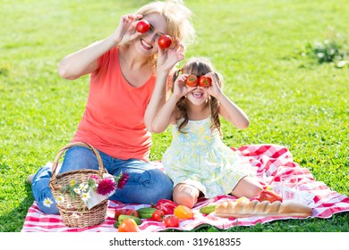 Family having fun while picnicking in summer park