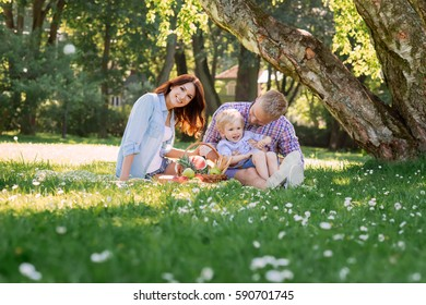 Family having a great time in the park. Father playing with son.