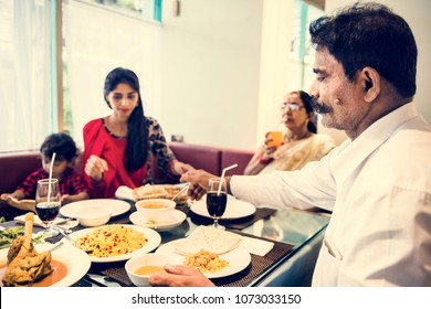 Family having Indian food