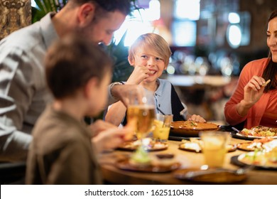 A family having a meal together in a restaurant.