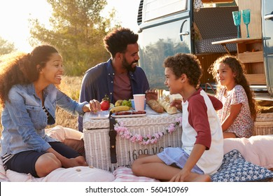 Family having a picnic beside their camper van