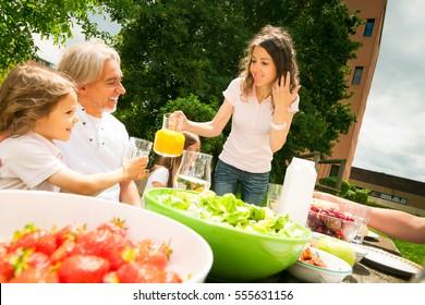 Family Having A Picnic In The Garden