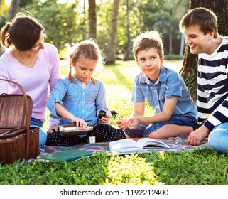 Family having a picnic in the park