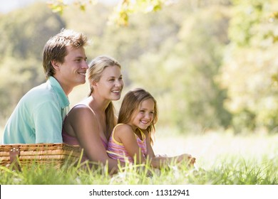 Family having picninc in countryside