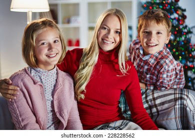 Family having rest at home on Christmas evening