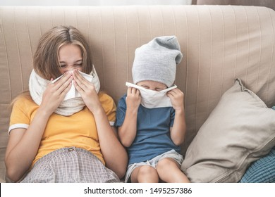 Family health concept. Children sneeze and wipe their noses. Big sister and little brother playing sick cold.