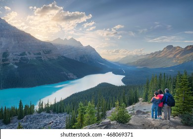 family of hikers enjoying the setting sun at Peyto Lake