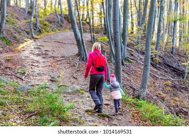Family hiking in the Autumn Forest.