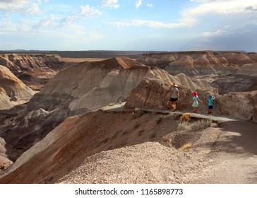 Family hiking on Blue Mesa Trail, Petrified Forest National Park