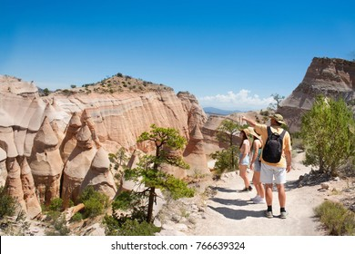 Family  hiking on vacation in beautiful mountains. Kasha-Katuwe Tent Rocks National Monument, Close to  Santa Fe, New Mexico, USA