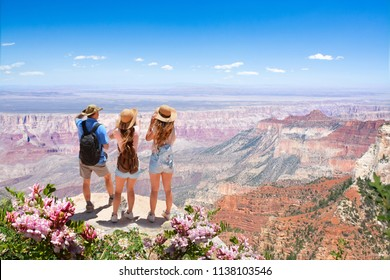 Family hiking on vacation,relaxing on top of the mountain, looking at beautiful summer mountains landscape. North Rim. Grand Canyon National Park, Arizona, USA.