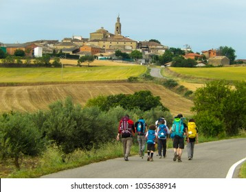 Family hiking together on the El Camino de Santiago in Spain