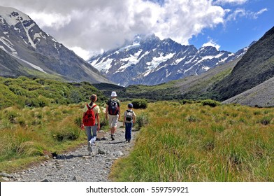 Family hiking toward Mount Cook, South Island, New Zealand