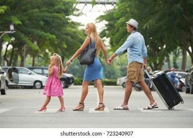 Family holding hands when crossing the road