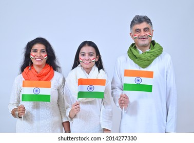 Family holding Indian flag on Independence day India - Shutterstock ID 2014277330