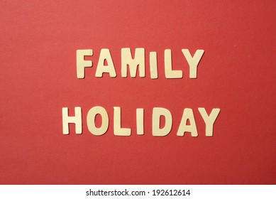 Family Holiday text on red paper background