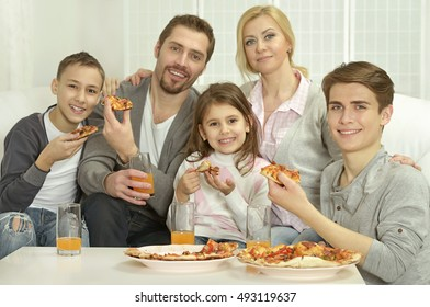 family at home with pizza