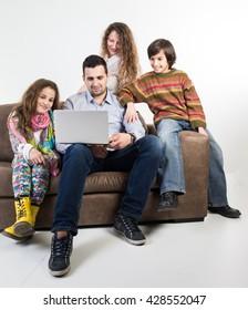 Family at home sitting at sofa