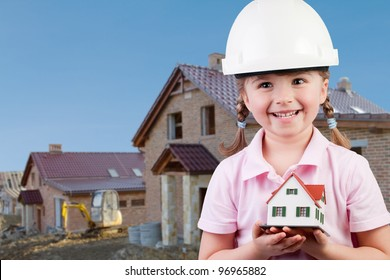 Family house concept - Outdoor portrait of lovely girl with house model
