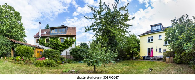 family house with garden and trees in planet perspective