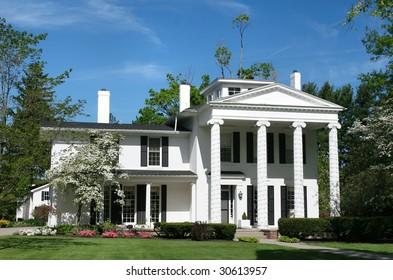 Family house in a green setting, suburban neighborhood setting