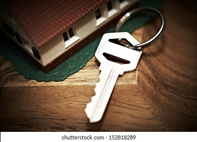 Family house with key. Real estate background.