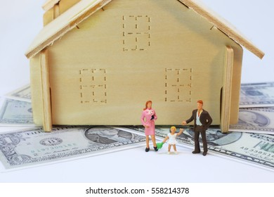 Family and house on dollar background.